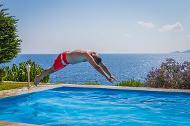 Man Diving In A Swimming Pool By The Sea