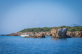A Sailboat By A Cliff In The Sea Of Lefkada In Greece
