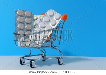 Capsules, Pack Of Medicines In Shop Trolley With Medicine Blue Background, Pills Concept, Buy And Sh