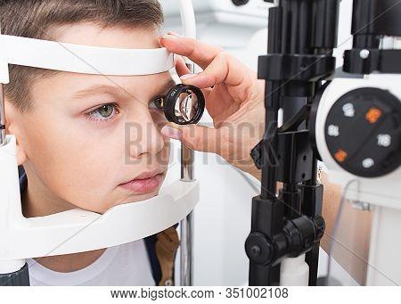 Boys Eyesight Test With Binocular Slit-lamp. Checking Retina Of A Teenagers Eye Close-up. Ophthalmol
