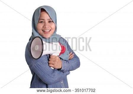 Portrait Of Young Asian Muslim Businesswoman Wearing Hijab Holding A Megaphone On Her Chest, Tough C