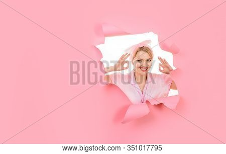 Smiling Woman Shows Sign Ok Looking Through Paper Hole. Portrait Of Nice Cheerful Positive Attractiv