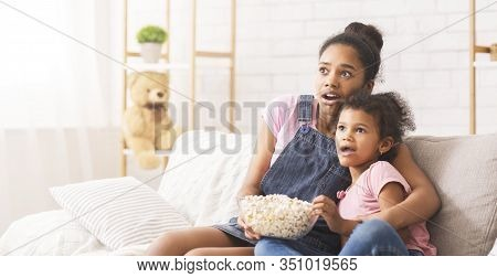 Scary Movie. African Sister Emotionally Watching Tv At Home, Panorama, Empty Space
