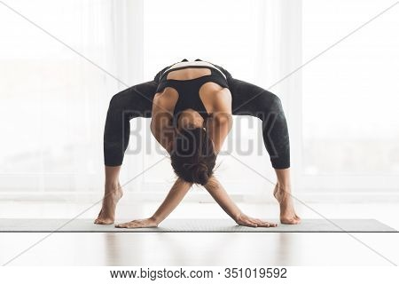 Fit Body Concept. Flexible Yogi Standing On Tiptoes With Crossed Hands On Mat, Practicing Artistic Y