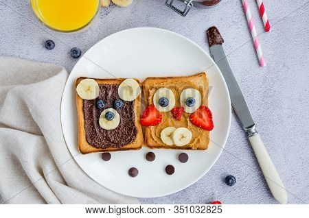 Healthy Funny Face Sandwiches For Kids. Animal Faces Toast With Peanut And Hazelnat Chocolate Butter
