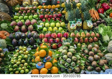 Spain, Barcelona, March, 10, 2018 - La Boqueria Market With Vegetables And Fruits In Barcelona. Spai