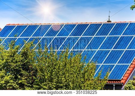 Solar Panel On Residential House Rooftop. Solar System On Home Roof Close-up. Many Blue Solar Cells