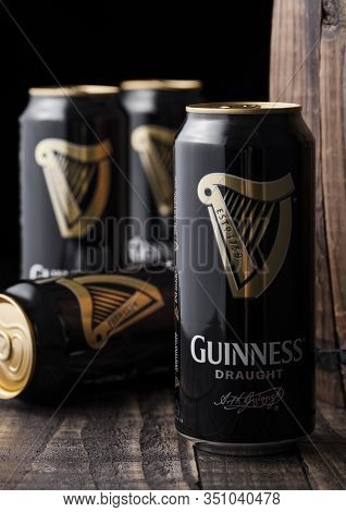 London, Uk - April 27, 2018: Aluminium Cans Of Guinness Draught Stout Beer  Next To Old Wooden Barre