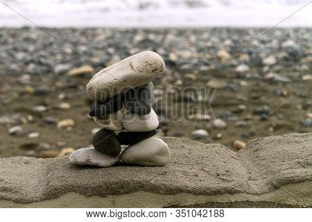 Zen-like Stone Pyramid Standing On A Rock At The Sea Beach
