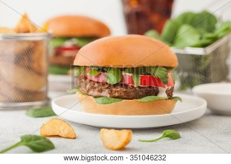 Healthy Vegetarian Meat Free Burgers On Round Ceramic Plate With Vegetables On Light Background With