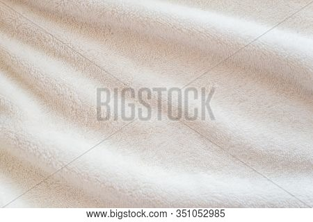 White Delicate Soft Background Of Plush Fabric Cozy Plaid. Texture Of Beige Soft Fleecy Blanket Text