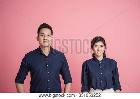 Happy Asian Smiling Couple On Pink Background