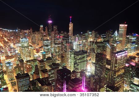 Chicago downtown aerial view at night with skyscrapers and city skyline at Michigan lakefront.