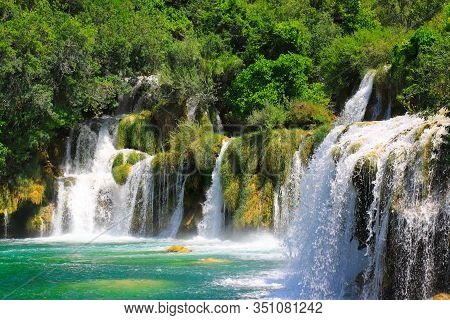 A Picturesque Waterfall Among Large Stones In The Krka Waterfalls, Lakes Landscape Park, Croatia In