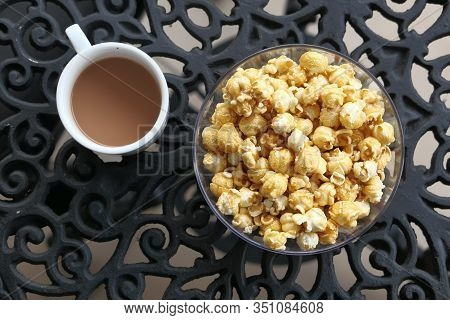 Top View Of Popcorn And Tea On Table For Breakfast