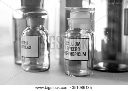 Medicine Vintage Bottles With Pyridoxin Chemicals At Pharmacy Shelf. Chemical Laboratory Glassware A