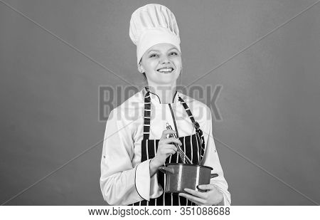 Woman Professional Chef Hold Whisk And Pot. Whipping Like Pro. Girl In Apron Whipping Eggs Or Cream.