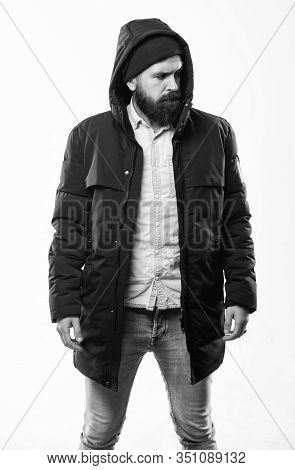 Hipster Outfit. Man Bearded Hipster Stand In Warm Black Jacket Parka Isolated On White. Hipster Mode