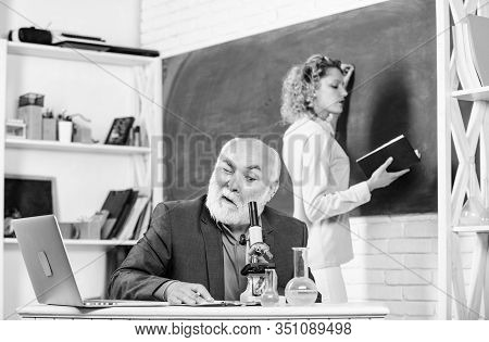 Biology Science. Student Study. Educator And Student Classroom. Girl With Notepad Near Chalkboard. C