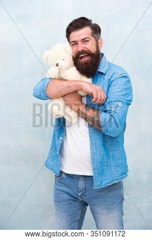 Pure Feelings. Happy Birthday Party. Toy Shop Concept. Brutal Hipster Hold Lovely Bear Toy. Happy Va