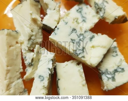 Pieces Of Dorblu Cheese On An Orange Plate, Close-up