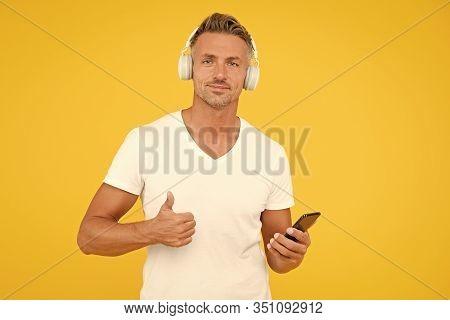 Listen Good Song. Guy Modern User Mobile Application. Favorite Music Playlist. Music Subscription. M