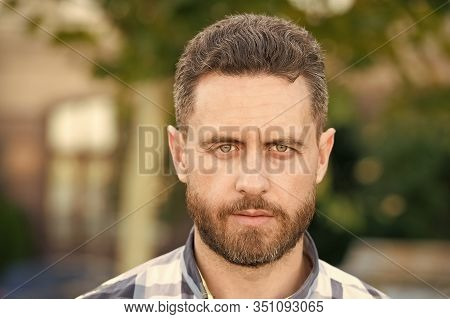 Bearded For Her Pleasure. Bearded Man On Urban Background. Unshaven Guy With Bearded Face. Handsome