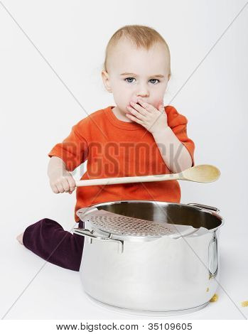 Baby With Big Cooking Pot And Wooden Spoon