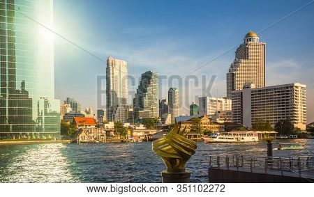 Bangkok Skyline As Seen From The Eastern Chao Phraya River Embankment At Sunset