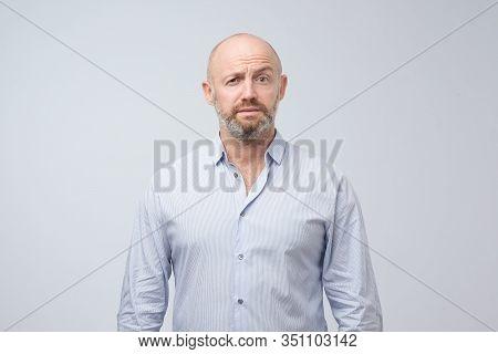 Doubt, Mistrust, Distrust Concept. Mature Man Looking With Disbelief Expression