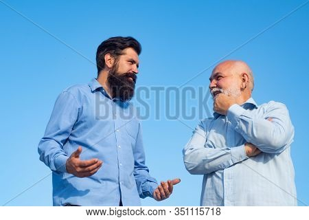 Handsome Senior Men In Blue Shirt. Male Multi Generation Family Walking. Happy Grandfather And Fathe