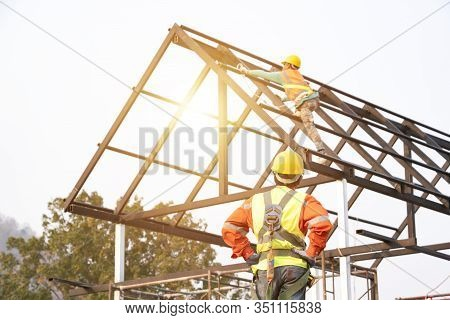 The Construction Worker Supervises The Construction Of The Roof Structure, The Construction Area And