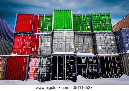 The National Flag Of United Arab Emirates On A Large Number Of Metal Containers For Storing Goods St
