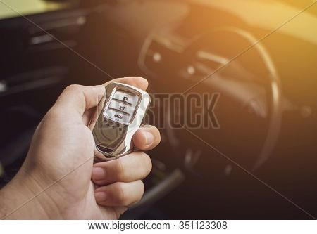 Driver's Hand Holding The Car Keyless Remote.