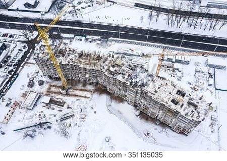 Construction Of A Multi-storey Residential Building At Winter Time. Aerial View From Flying Drone