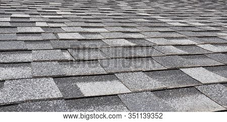 Asphalt Shingles Panoramic Photo. House Rooftop Asphalt Roofing Shingles Textured Background.