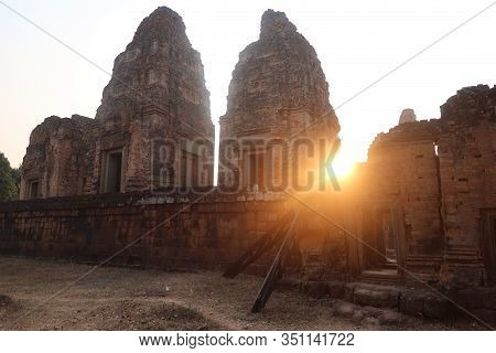 Sunset, Sun Shining Through Old Angkor Wat Tower Ruins Of Khmer Empire, Tourism Tour Desination In C