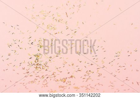 Gold Holographic Glitter On Pink Background, Abstract Texture.