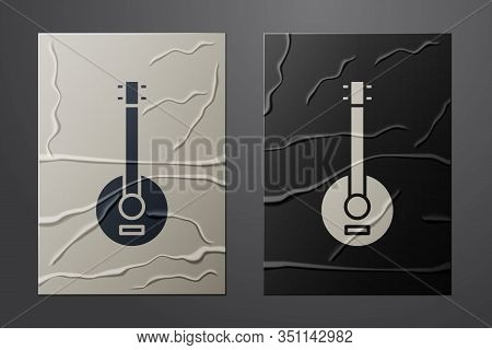 White Banjo Icon Isolated On Crumpled Paper Background. Musical Instrument. Paper Art Style. Vector