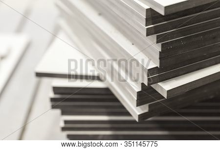 Stack Of White Textolite Sheets. This Is Layered Composite Material Based On Fabric From Fibers And