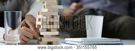 Focus On Wooden Tabletop Board Game. Happy People Spending Quality Time With Close Friends Or Relati