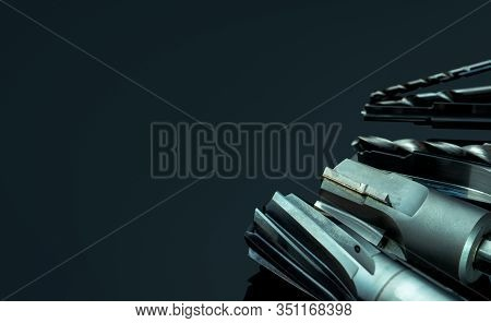 Special Tools Isolated On Dark Background. Made To Order Special Tools. Coated Step Drill And Reamer
