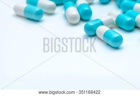 Selective Focus Antibiotic Capsule Pills On White Background. Antibiotic Drug Resistance Concept. Ph
