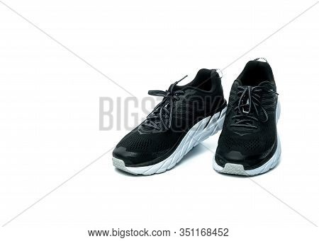 Pair Of New Running Shoes Isolated On White Background. Black Sneakers. Breathable Fabric Sport Shoe