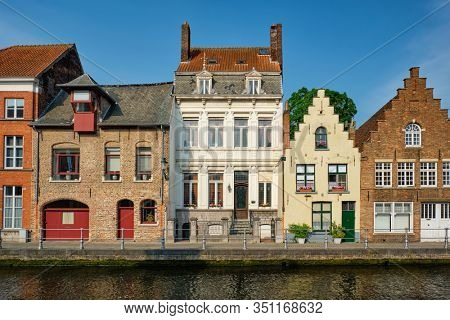 Bruges typical Belgian cityscape Europe tourism concept - canal and old Flemish houses. Brugge, Belgium