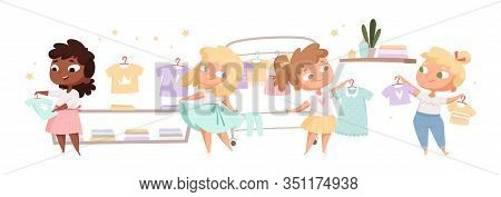 Little Fashionistas. Cute Girls Choose Clothes, Try On Dresses And T-shirts. Young Ladies Play In St