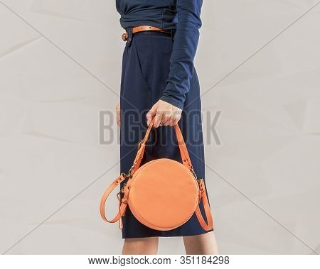 Stylish Fashionable Woman With Orange Round Bag