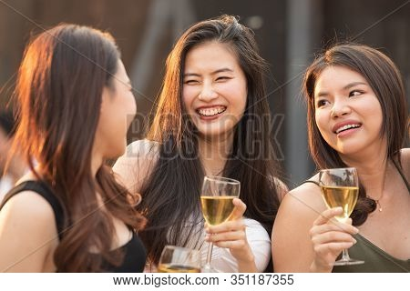 Group Of Young Beautiful Happy Asian Women Holding Glass Of Wine Chat Together With Friends While Ce