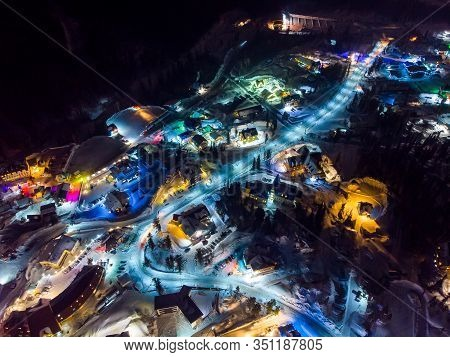 Sheregesh Kemerovo Region Ski Resort In Winter, Night Landscape On Mountain And Hotels, Aerial View