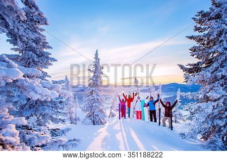 Beautiful Winter Landscape With Forest Snow In Mountains With Team Of Friends Snowboarders And Skier